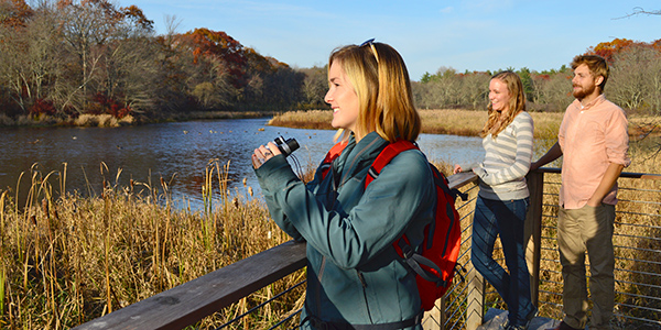 people enjoying the river overlook at The Sawmill