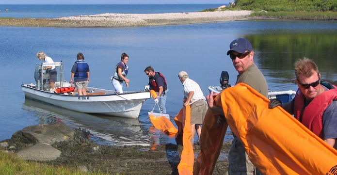 volunteers and first responders practice an oil spill response on Buzzards Bay